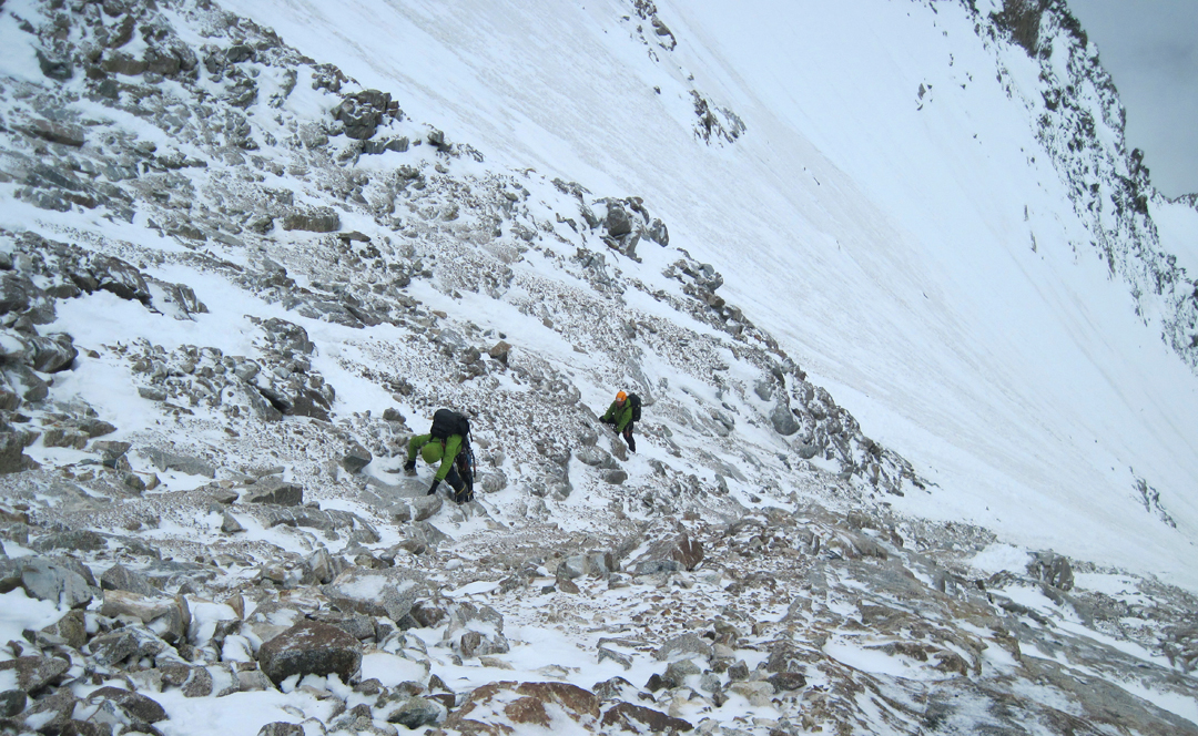 Paul Figg and Simon Yearsley negotiate loose mixed ground between icefields during the first ascent of Dunglung Kangri.