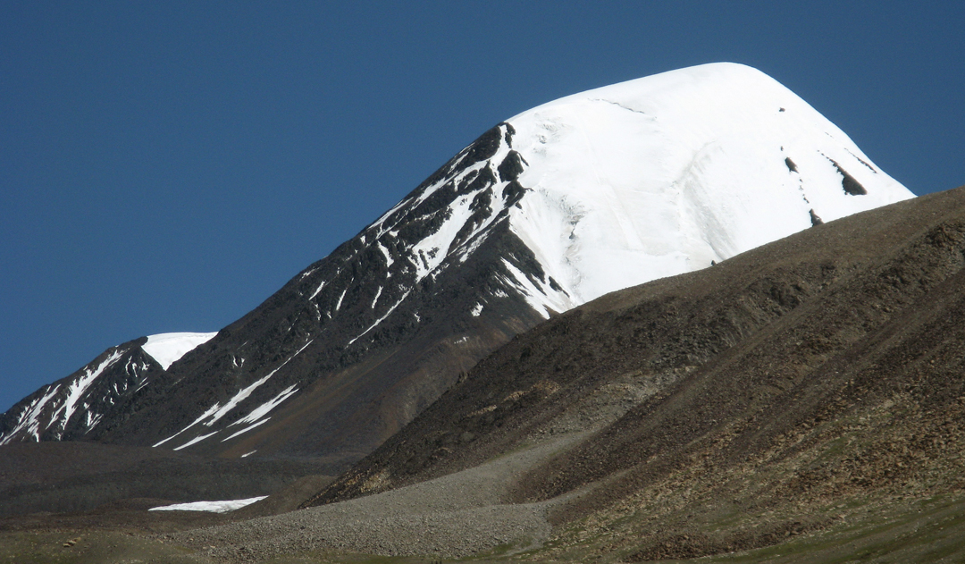 Gazgazri, west and south faces. The first ascensionists climbed the southwest ridge  facing the camera, before traversing onto the icy south face.
