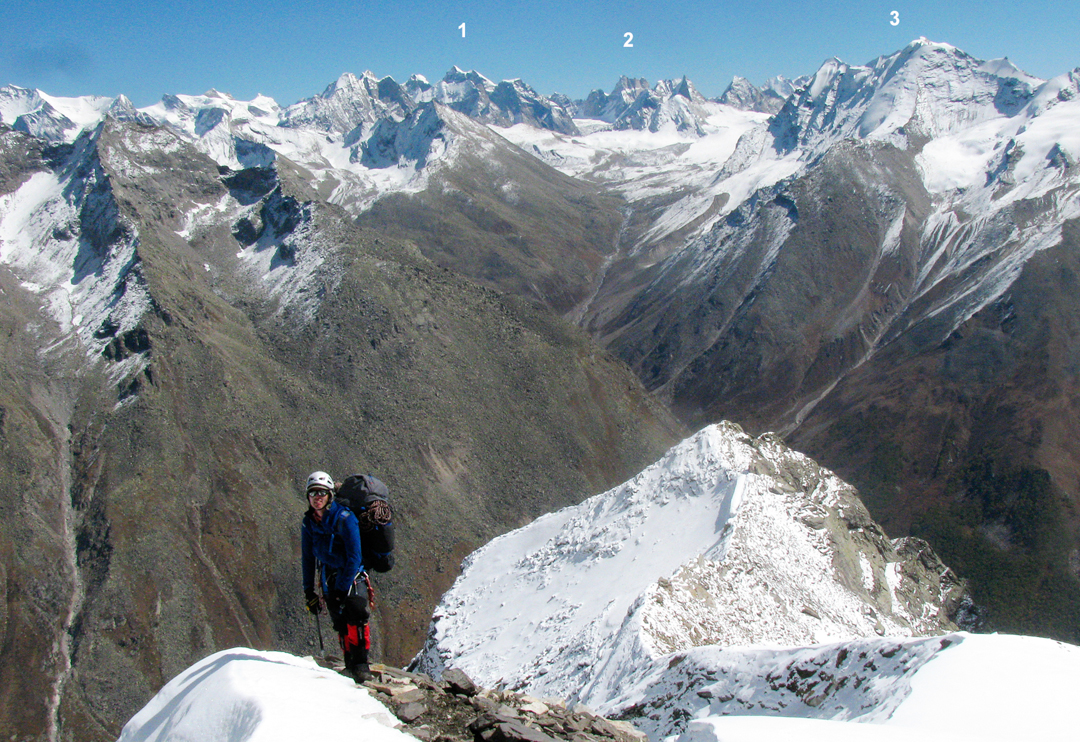 Ian Cartwright during an attempt on the east ridge of Shiva. In the distance are the peaks of the Miyar Valley, e.g. (1) Devil's Horns - Jangpar Glacier, and (2) Mahindra. (3) is the Baheli Jot massif (5,600m).  Shakkar Peak just off picture left.