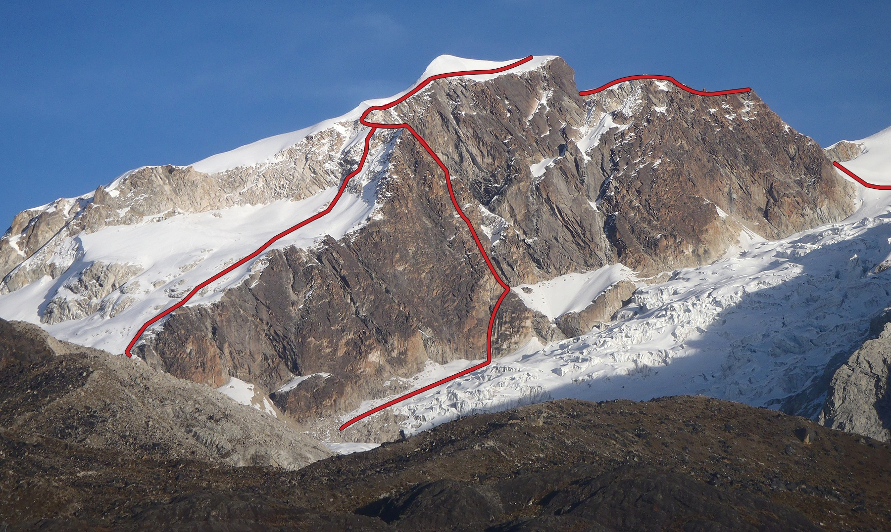 "East face of Pico Italia showing the ""normal"" south to north traverse, and the 2012 rock route on the east face buttress."