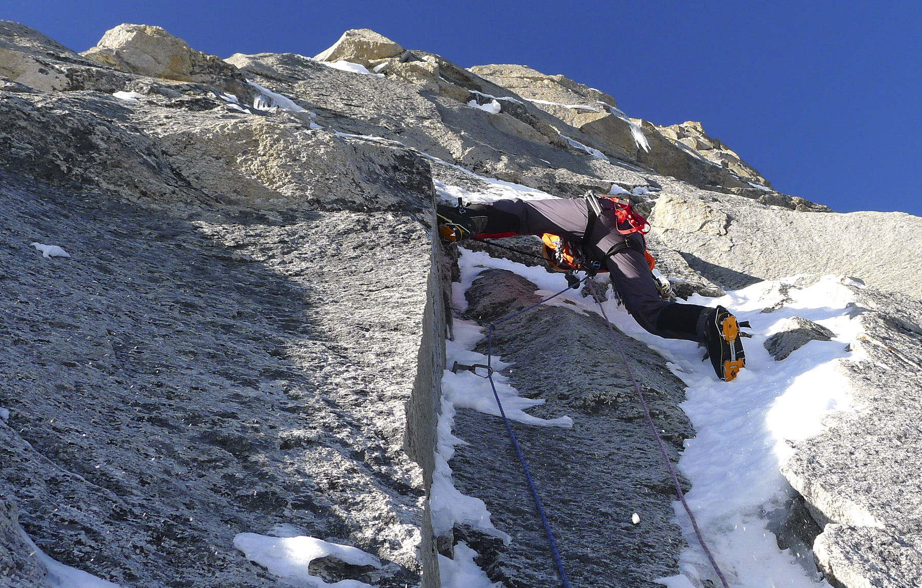 Paul Ramsden works through steep granite on the lower third of the Prow, five days out from base camp. Mick Fowler
