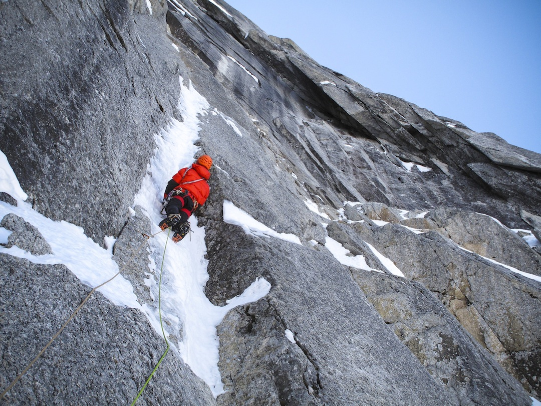 Christophe Dumarest climbing thin ice smears during the first ascent of Largo's Route.