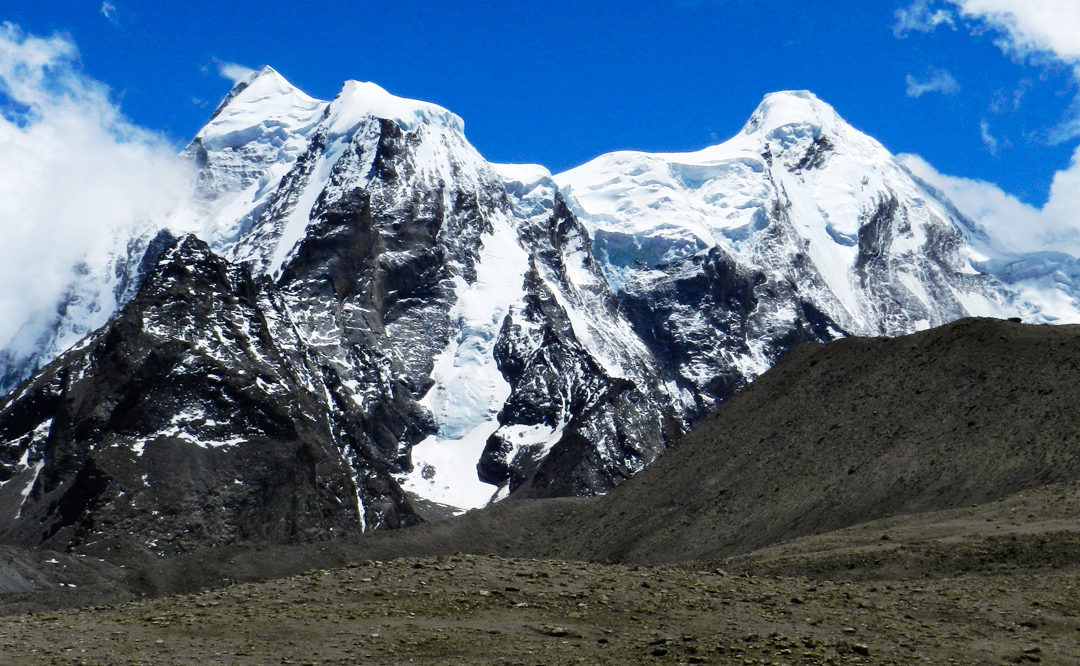 The Gurudongmar peaks from the Plateau to the north: main summit (6,715m) left, and west summit (6,630m). In 1936 Kempson and Shipton reported climbing Gurudongmar via the west ridge, but it seems likely they just reached Gurudongmar West, considering the east summit as something else entirely. The main (east) summit was climbed from the northeast in 1991 by Indians.