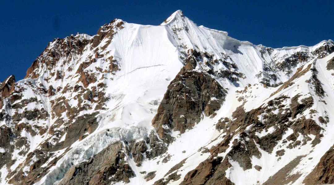 Unclimbed T3 (5,934m) rises above the Kangla Glacier.
