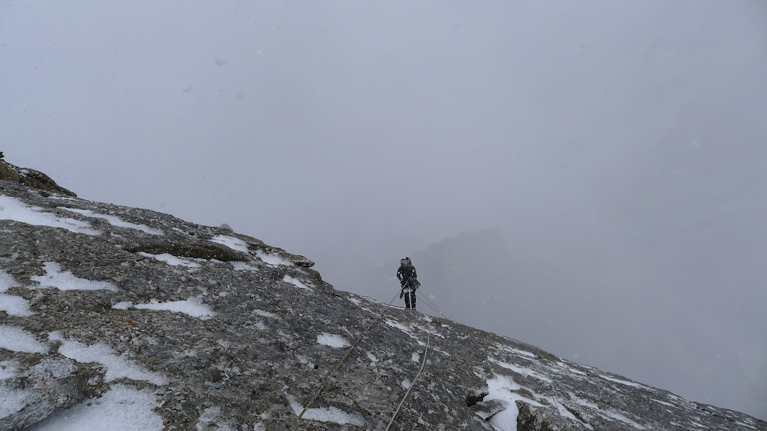 Pete Fasoldt rappels the north face of Peak 4,810 in a strengthening storm.