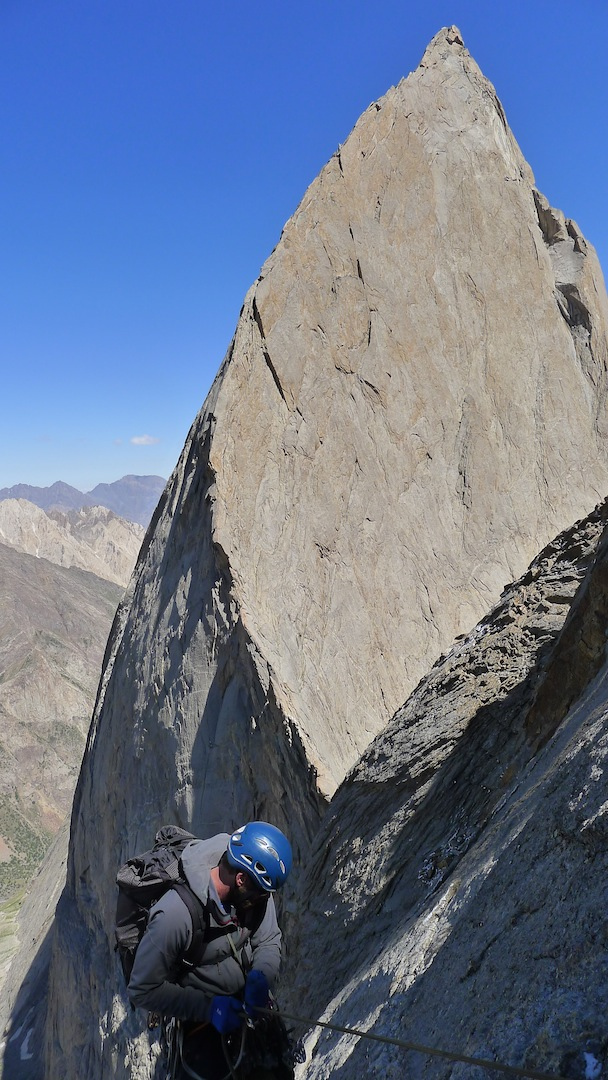 Pete Fasoldt rappels toward the stunning, knife-edged south ridge (600m, 5.10+) of Peak 1,000 Years of Russian Christianity.
