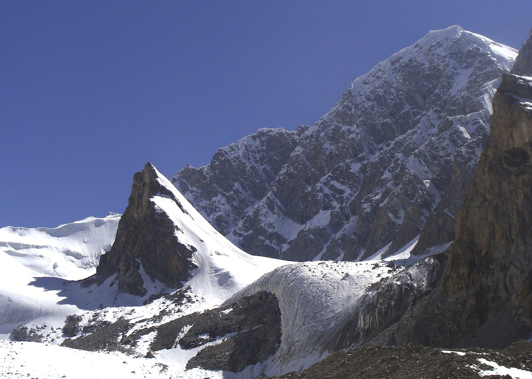 The steep, mixed east-northeast face of Koh-e-Wark. This peak has only been climbed twice, in 1963 (four Austrians) and in 1976 (two Poles). In the foreground is the small but elegant unnamed peak climbed in 2012 by snow slopes on the far side. Koh-e-Tokan is just off picture left.