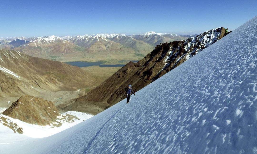 On the upper slopes of Koh-e-Elgha Eli IV with Lake Chaqmaqtin and Tajikistan Pamir beyond.