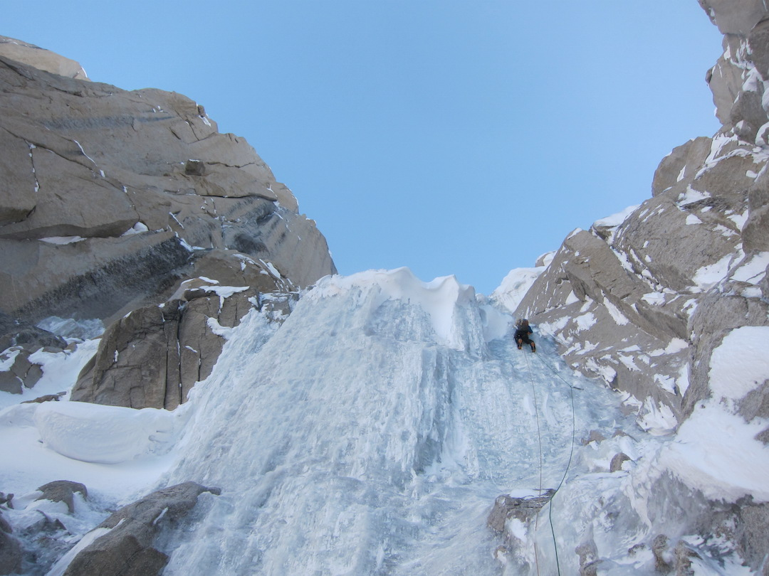 Urban Novak in the lead on the steep ice step of K7's east face.