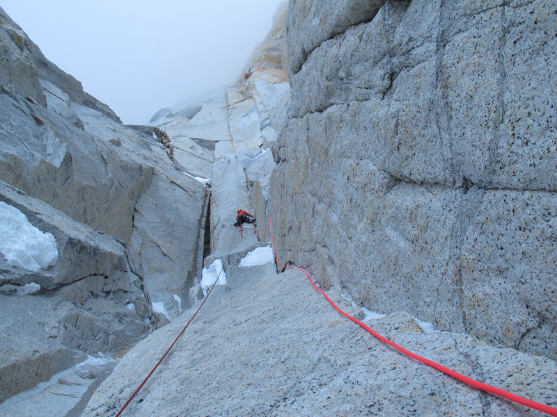 """Jorge Ackermann forges up a dihedral toward steeper rock overhead. The lower route was relatively sheltered, so the pair took a chance and approached the face despite a storm. """"It was snowing and the wind was howling, but around us the air was still."""""""
