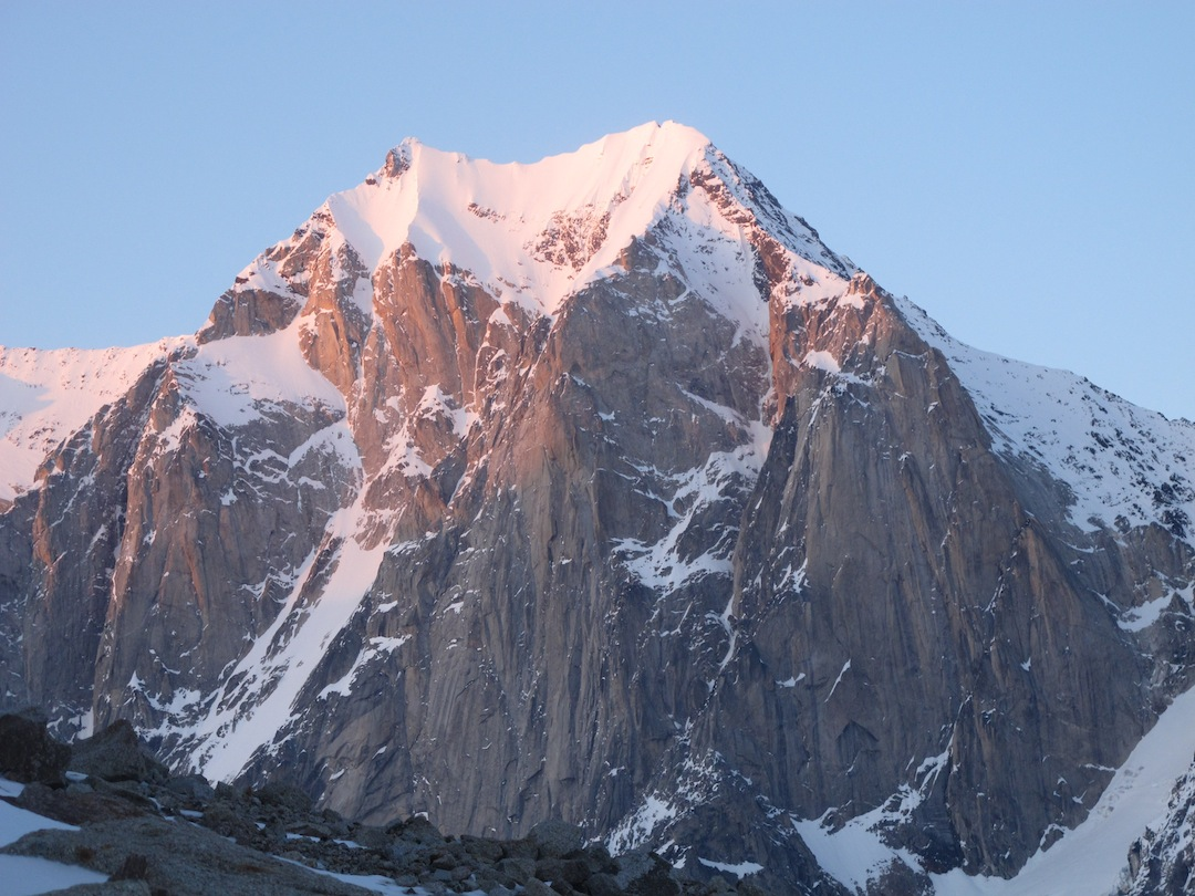 The west face of Apoc- alypse. The first ascent of the peak in April 2013 (A Cold Day in Hell, 4,400', AI5, Helander- Stuckey) followed a partially hidden ice line in right center. In 1983, a team climbed 1,500 feet up the central rock buttress. In 1985, Karl Swanson attempted to solo the ice line left of the buttress, reaching the upper snowfield.