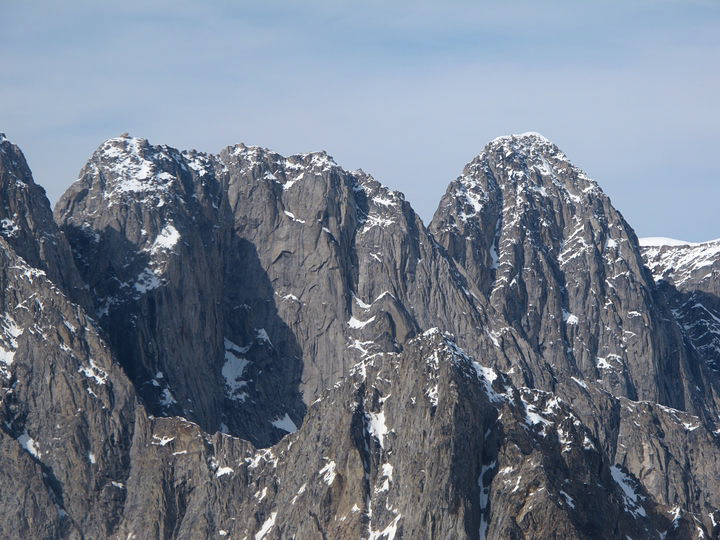 The unclimbed southeast faces of the North Horseman (ca 8,400 feet, left) and Pyramid Peak (8,572 feet, behind right), showing potential for good rock climbs. Three of the Four Horsemen have been climbed. The North Horseman has not.