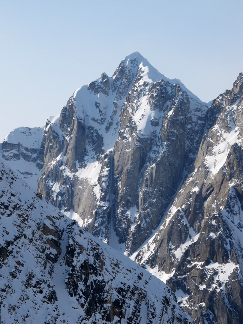 The 4,000-foot east face of South Buttress (9,345'). This beautiful peak has excellent granite and has seen only one ascent, via a couloir on the south face.