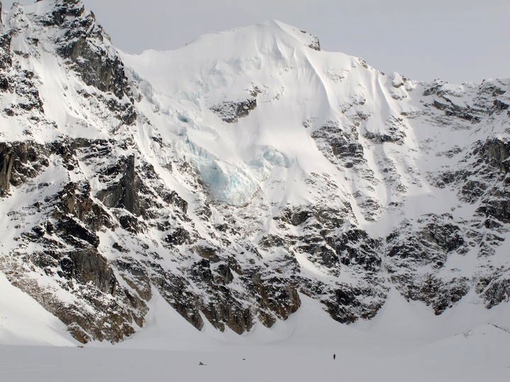 Peak 8,301', an attractive, unclimbed snow and ice peak at the head of the Swift Glacier,  near Mt. Mausolus. The vertical relief of this face is about 2,800 feet.