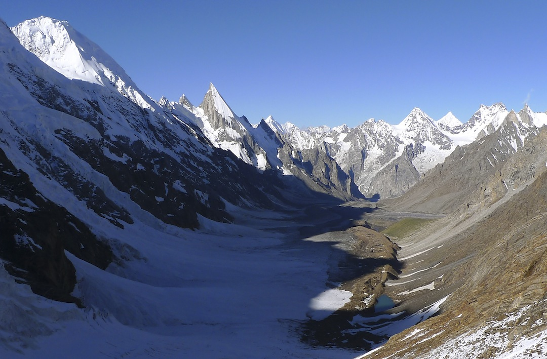 Looking south down the Gondokhoro Glacier from Gondokhoro La, a memorable view for those making the Askole–Baltoro Glacier–Hushe trek. The prominent ice spear left of center is Laila, and the winter ascent was made via the right skyline, the west face as seen in profile.