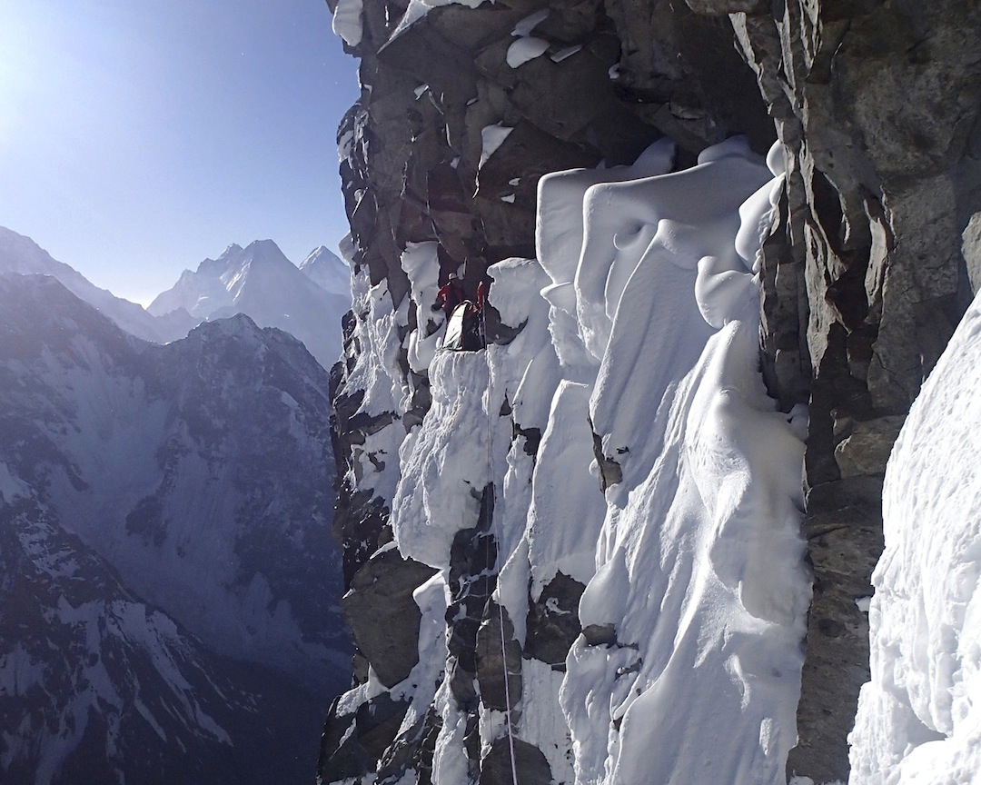 Precariously placed camp on the headwall of the northeast spur, with the Gasherbrum Group behind.