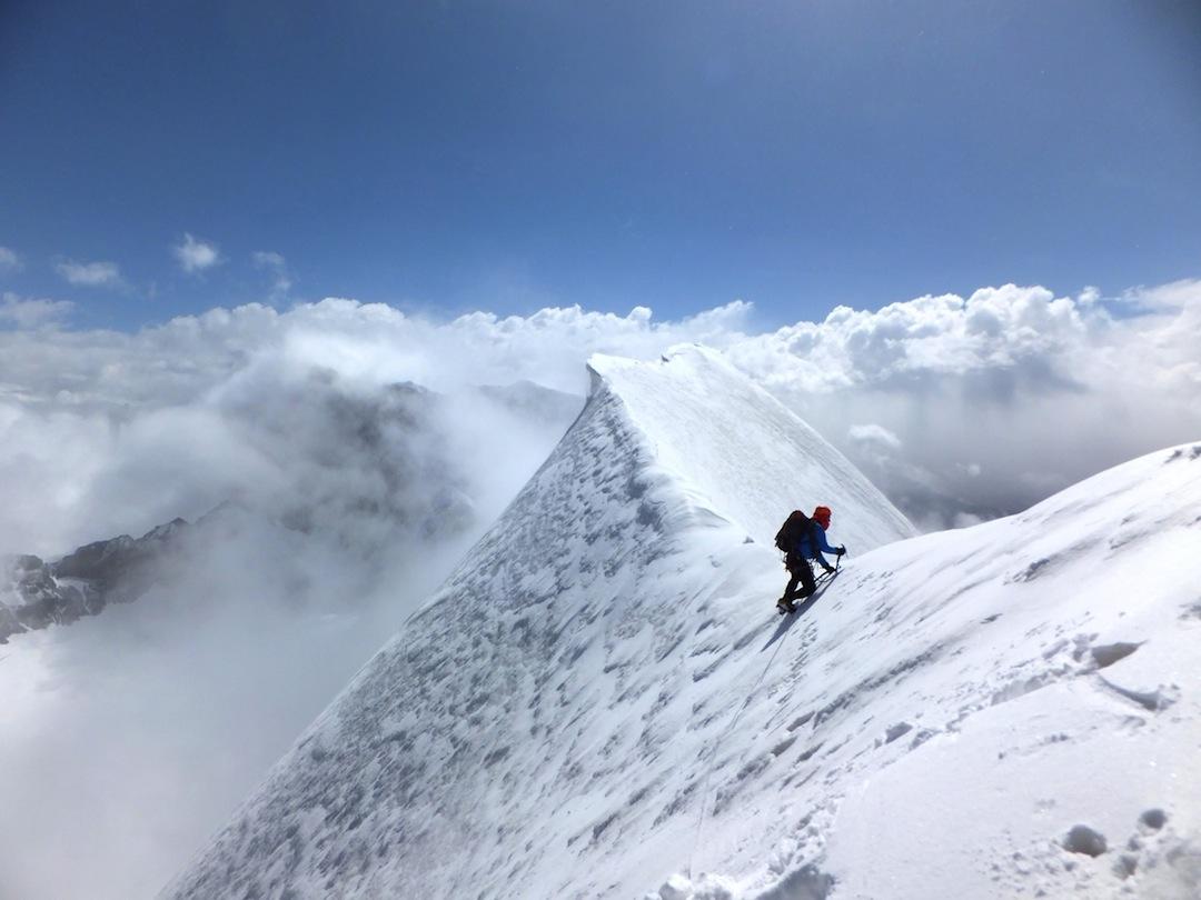 High above the clouds on the summit ridge of Peak Currahee (Peak 5,025m).