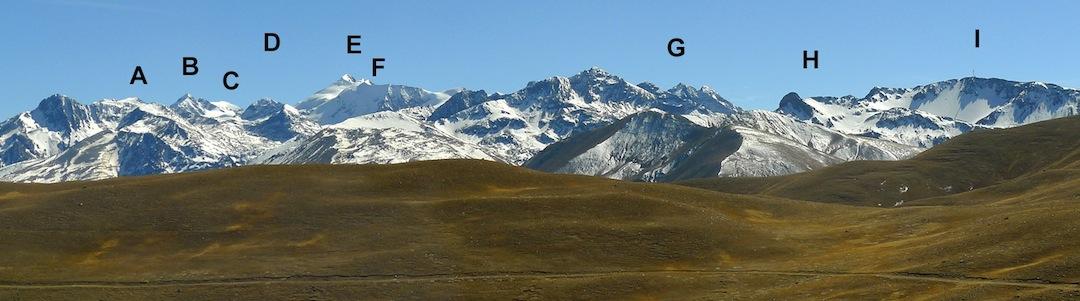 Panorama of the southern Quimsa Cruz from the south. (A) Santa Rosa. (B) Gigante Grande. (C) Cerro Sofia. (D) Cerro Piroja. (E) Jacha Cuno Collo. (F) Huayna Cuno Collo. (G) Cumbres Kasira. (H) Cerro Salta Khasa. (I) Cerro Salta Hita (with large mast on summit).