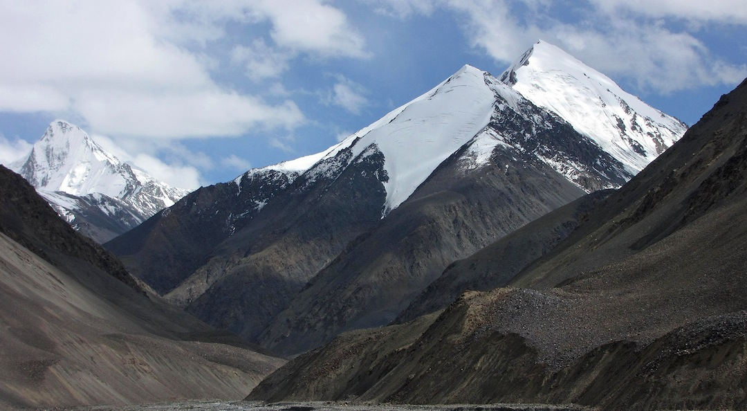 Koksil Sar I (6,176m) and Koksil Sar V (with unclimbed Pt. ca 5,450m in front) from the Karakoram Highway. The 2013 ascent of Koksil Sar V climbed the snow/ice face just this side of the right skyline.