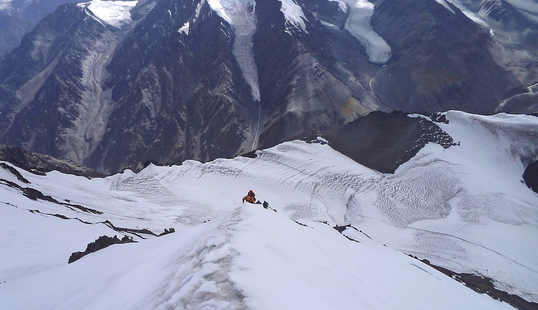 On the upper section of the southwest rib, looking down onto the Fourth Koksil Glacier and Chapchingol Valley beyond.