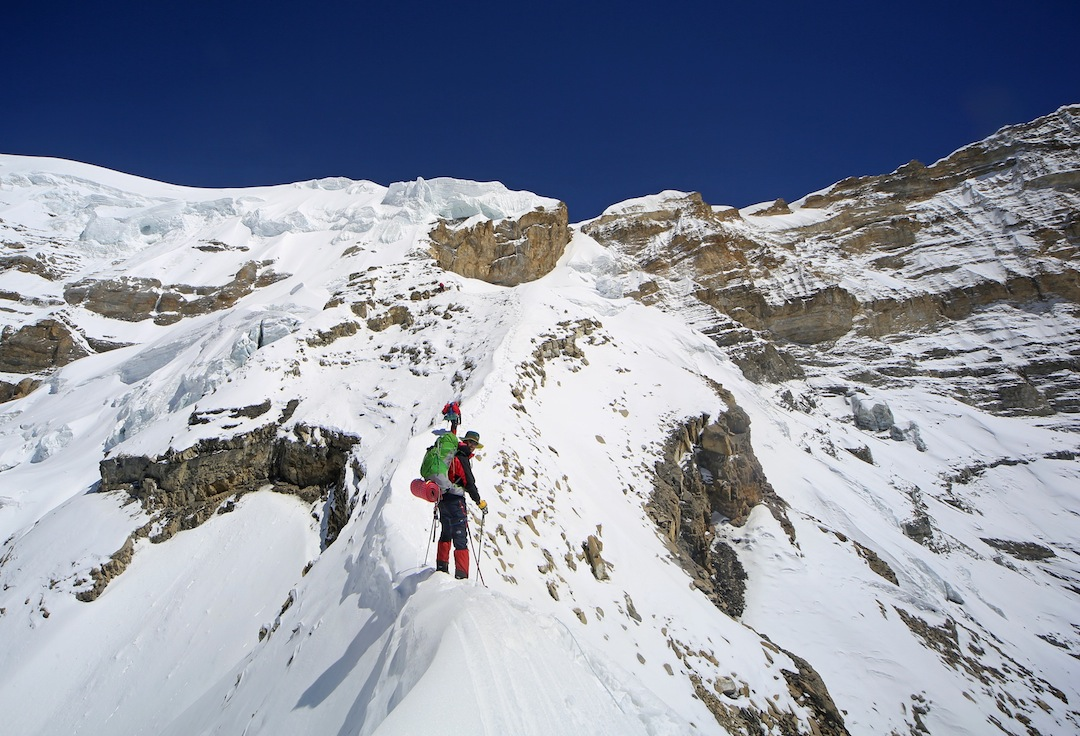 Climbing the Biscuit Ridge. The Korean Gate at the start of the Lagula's west ridge is the notch visible above and right of the climber. The ridge on the left leads to the summit of Bhrikuti Sail.