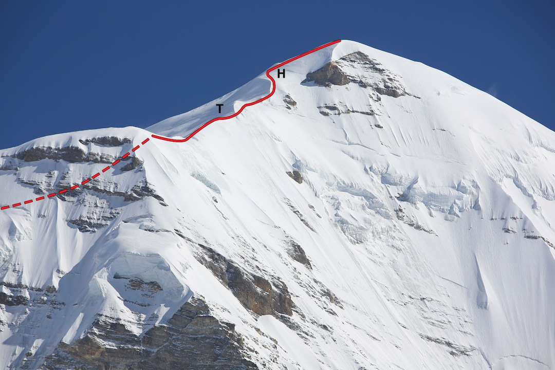 The upper section west ridge of Lugula, showing (T) Tiger Ridge, and (H) Hong's Step.