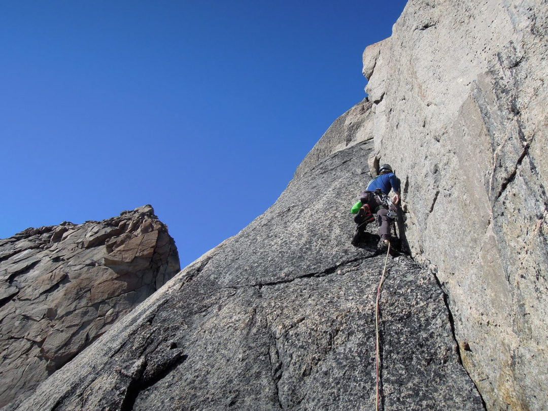 Climbing a 5.10 corner high on Mt. Loki.