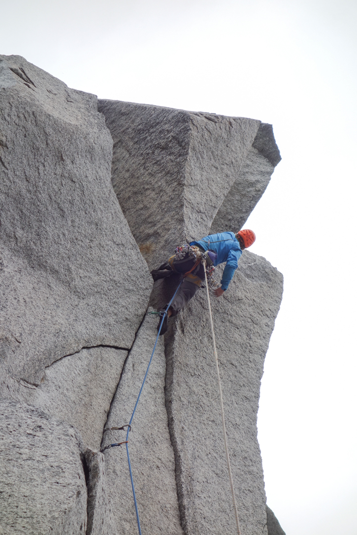 Chris Kalman on the first roof of the crux pitch.