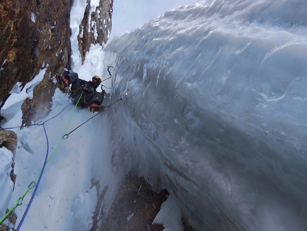 Scott Adamson revels in the thick ice along the crux pitch of NWS during the 2013 first ascent. Previous attempts had found little or no ice.