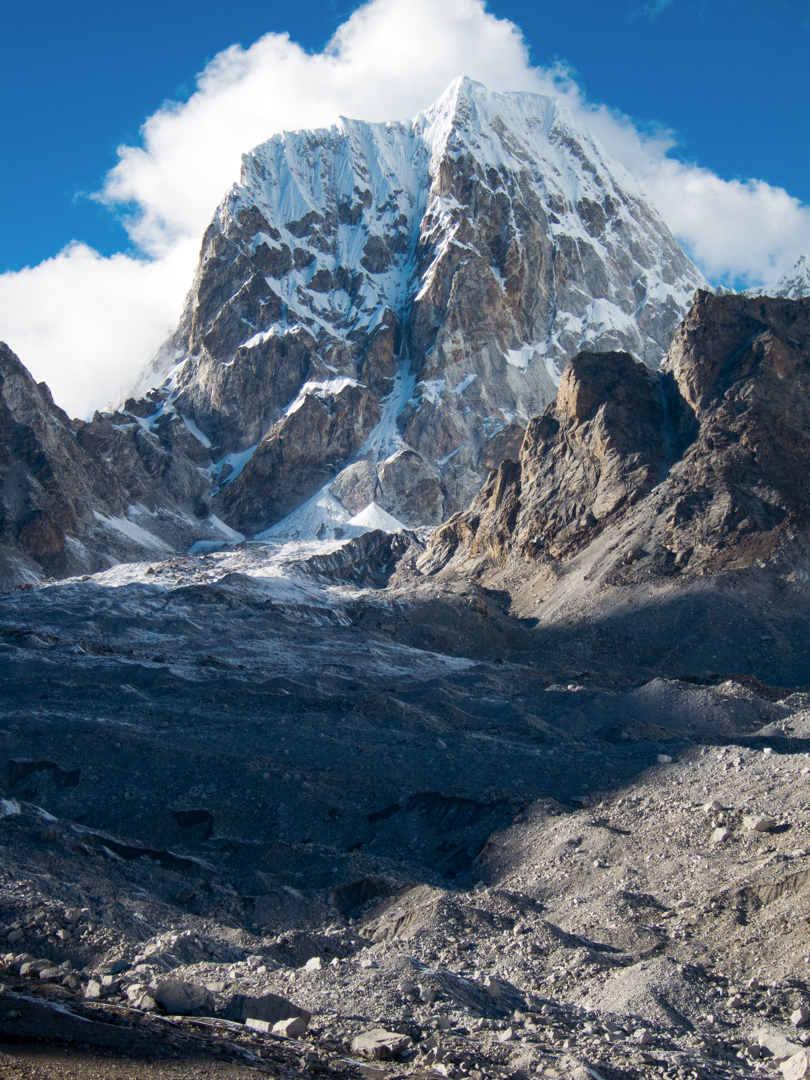 Lunag West (6,507m), with the obvious line of Open Fire splitting the southeast face. The 1,000-meter route was climbed in a 26-hour round trip from ABC.
