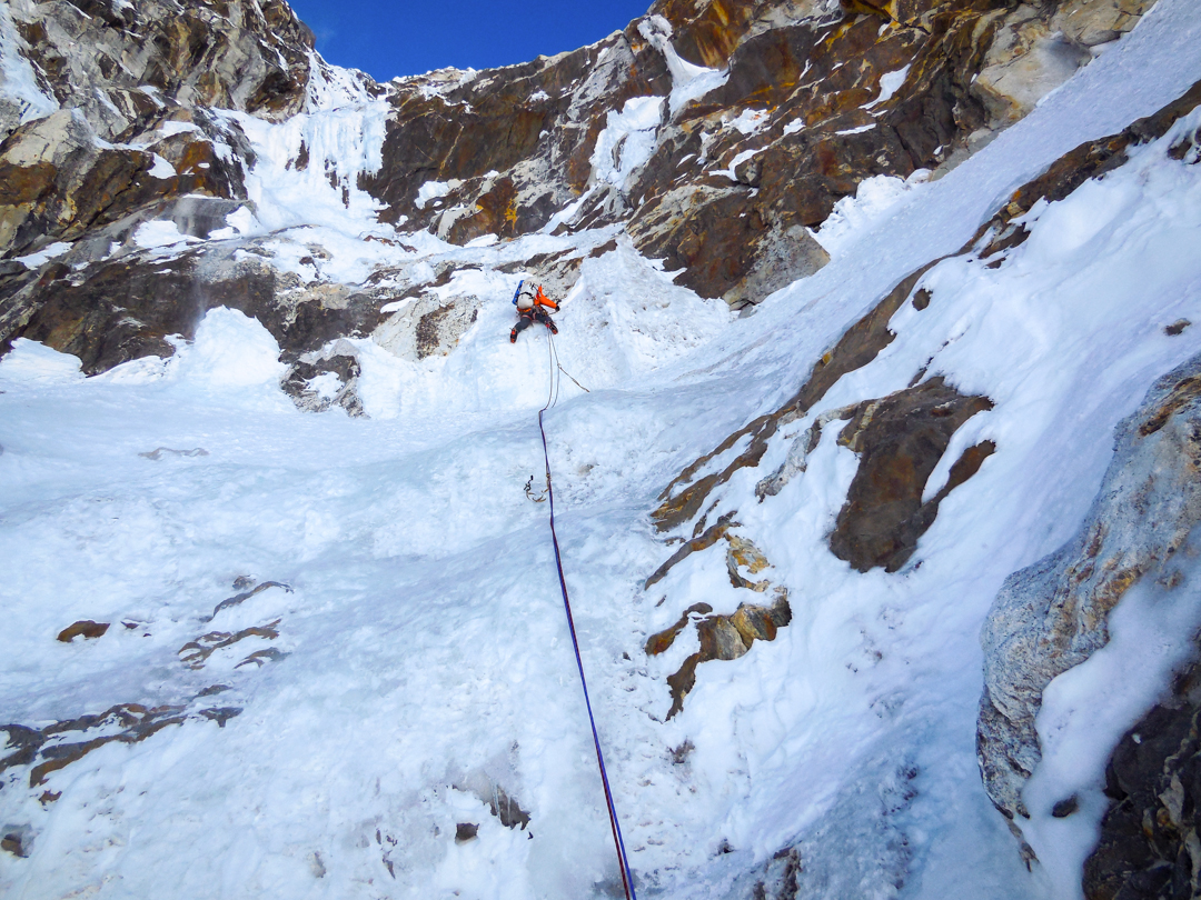 The author leads into the headwall on the northeast face of Pangbuk North. The crux pitch ascended the steep, rotten ice in upper left.
