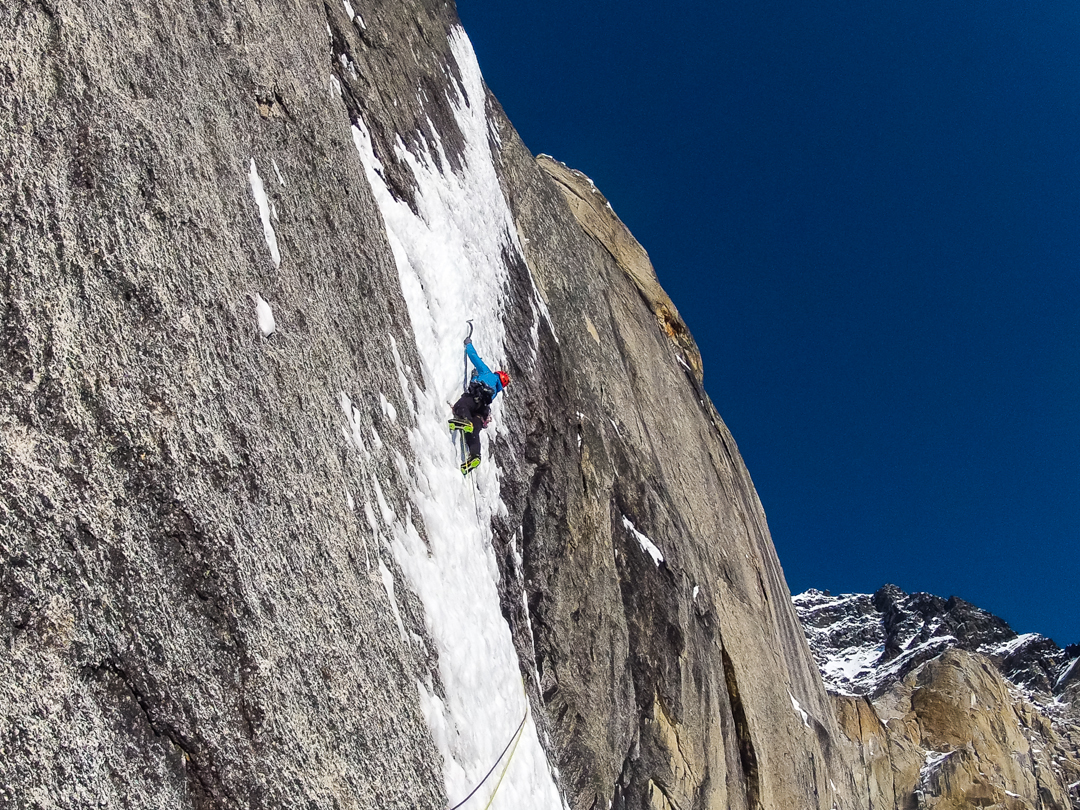 Peter Doucette gets committed on the crux WI6 ice smear of Twisted Stair.