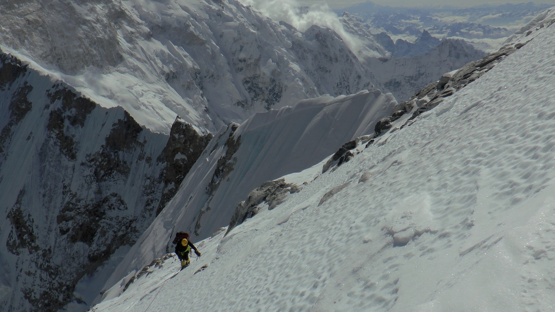 On the summit icefield at 7,100m with a view into Sikkim. The foreground ridge leads to Kangchenjunga South.