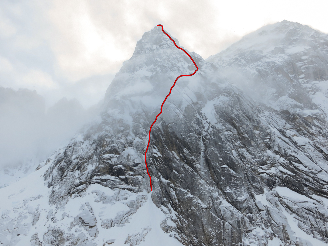 Dike Peak, showing the route Powered by Beans, which climbed thin ice runnels and névé up the center of the west face. The climbers descended the right skyline to the lower-angled slabs on the lower right-hand side of the photo.