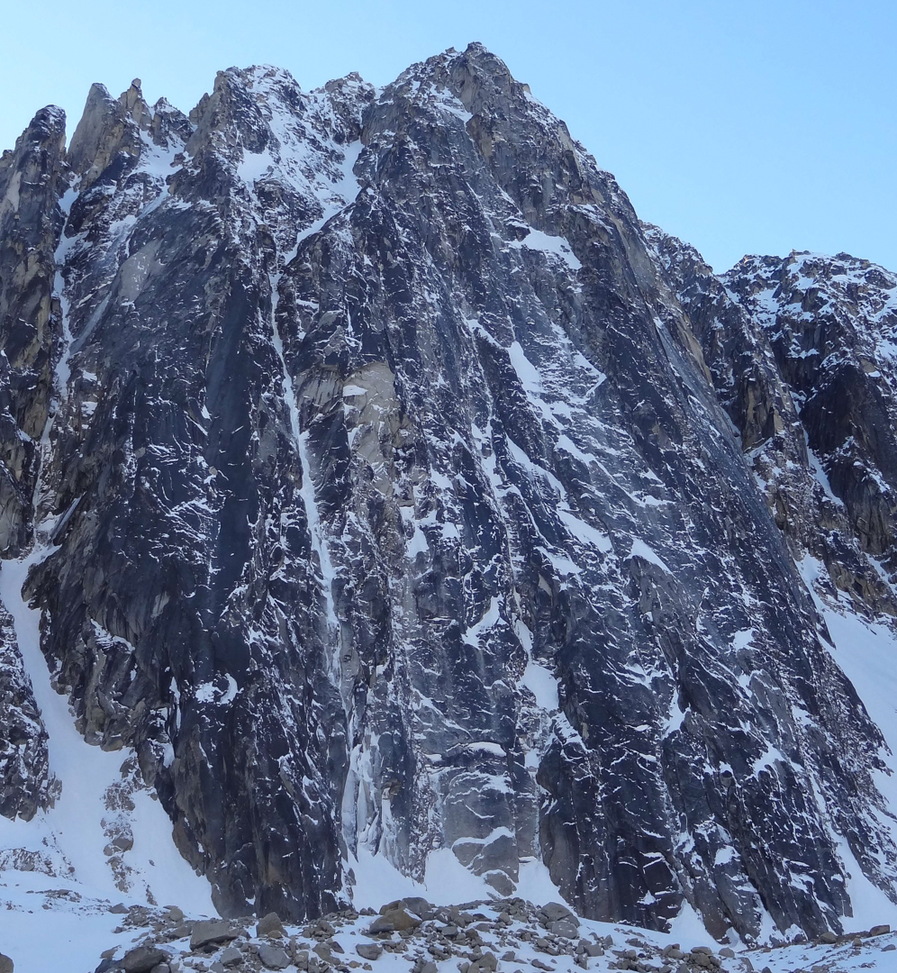 Mt. Boucansaud's east face. The line of the Illiad climbs the prominent ice and snow gully in the center-left of the face.