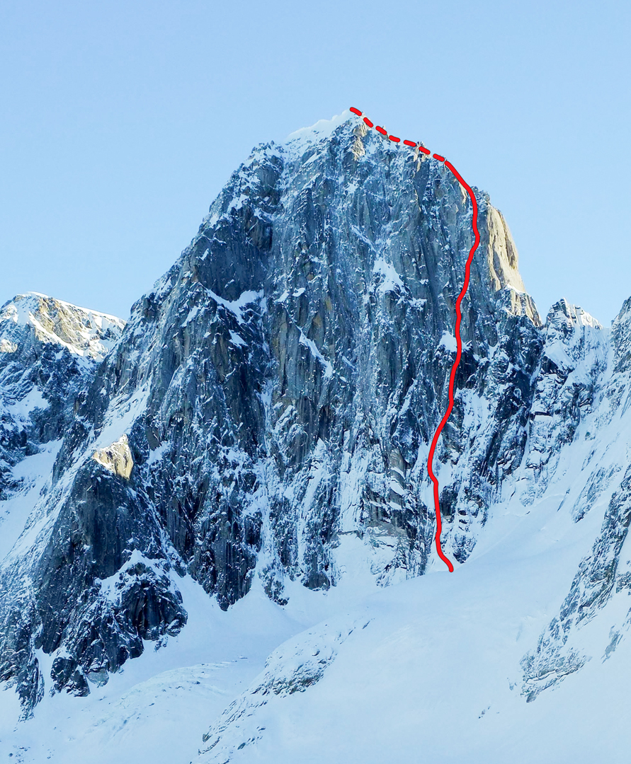 The line of the Odyssey on the right side of Pyramid Peak's west face. The difficult and sustained route allowed for the first ascent of the peak. The prominent gully center-left was attempted in 2013 by Clint Helander and Jason Stuckey, climbing six pitches. Canadian climbers Kris Irwin, Ian Welsted, and Darren Vonk attempted the gully in 2014, climbing 10 pitches to the prominent horizontal band of snow two-thirds of the way up the wall.