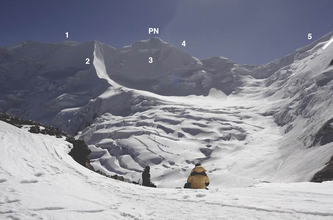 (PN) Pico Norte from the west ridge (normal route) of the main summit of Illimani, looking across the glacier basin used to approach south-side routes. (1) Upper west ridge of Pico Norte. (2) South spur attempted by Italians in 2014. (3) Via del Indio climbs the southwest face directly; it was a straightforward ice slope during the 1973 first ascent. (4) South ridge of Pico Norte. (5) North ridge of Pico Central (summit just off picture to right).