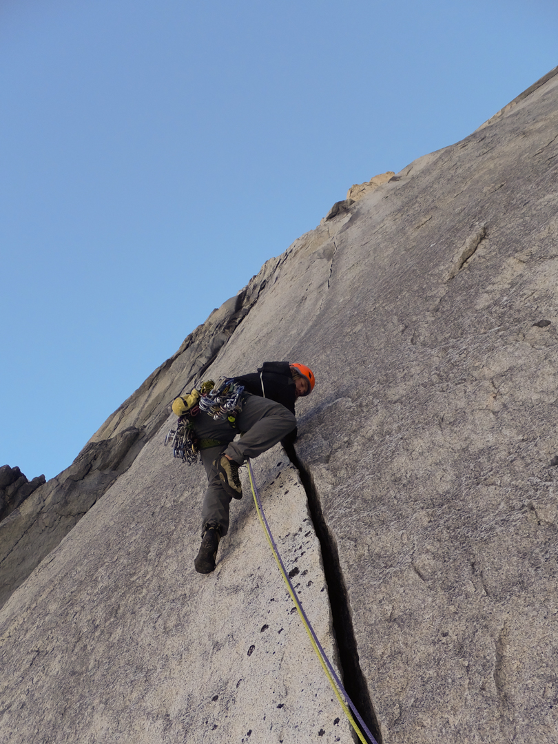 Max Fisher leading splitter hands on pitch two on an attempt of Kooshdakhaa Spire's granite wall.