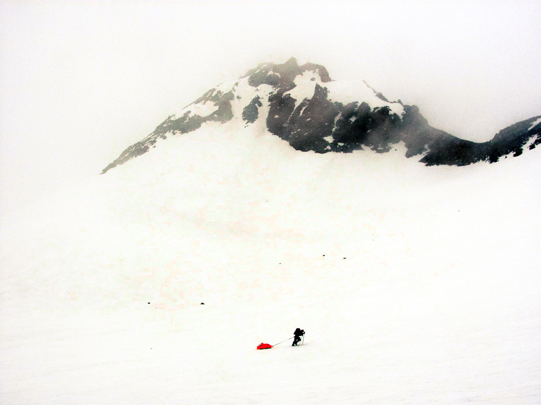 Dragging sleds under the Pilar Meridional.