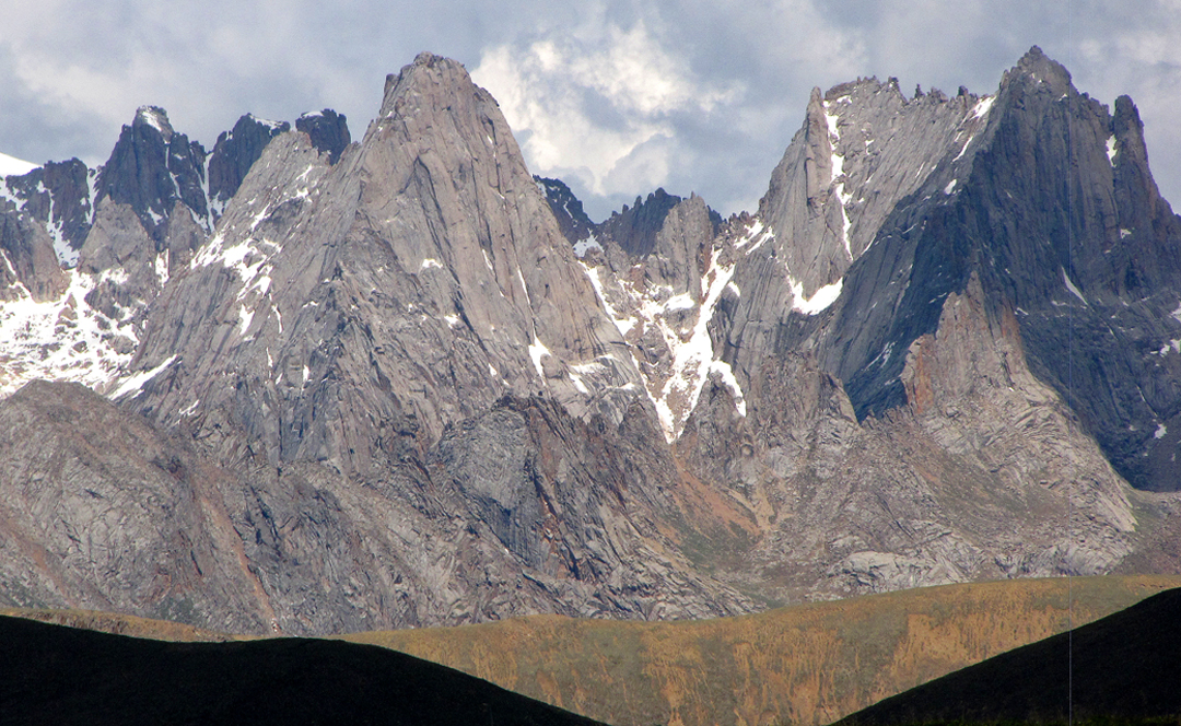 Unclimbed granite walls in the Nyainbo Yuze massif, seen from the northwest.