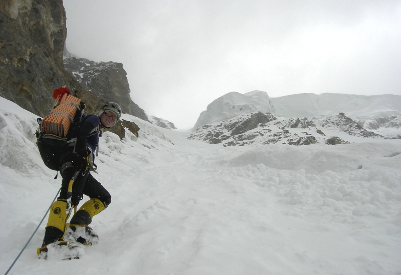 Irena Mrak in Messner Couloir during poor weather. Left is Mummery Rib; up and right Messner Serac threatens ascent.
