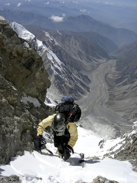 Irena Mrak at 7,500m in final gully leading to upper southwest (Mazeno) ridge. Below, flowing northwest, is rubble-covered Diamir Glacier.