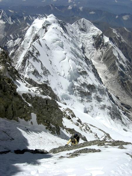 Irena Mrak in final gully leading to upper southwest ridge, with lower Mazeno Ridge behind.