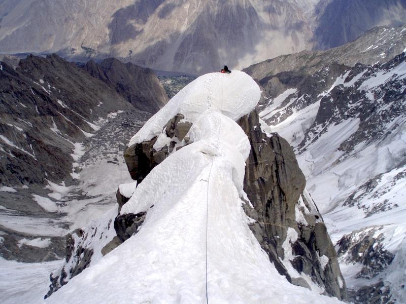 Klaudiusz Duda on top rib leading toward south col. Below him Bulkish Yaz Glacier runs down to distant Gulmit village and Hunza River (before 2010 landslide).