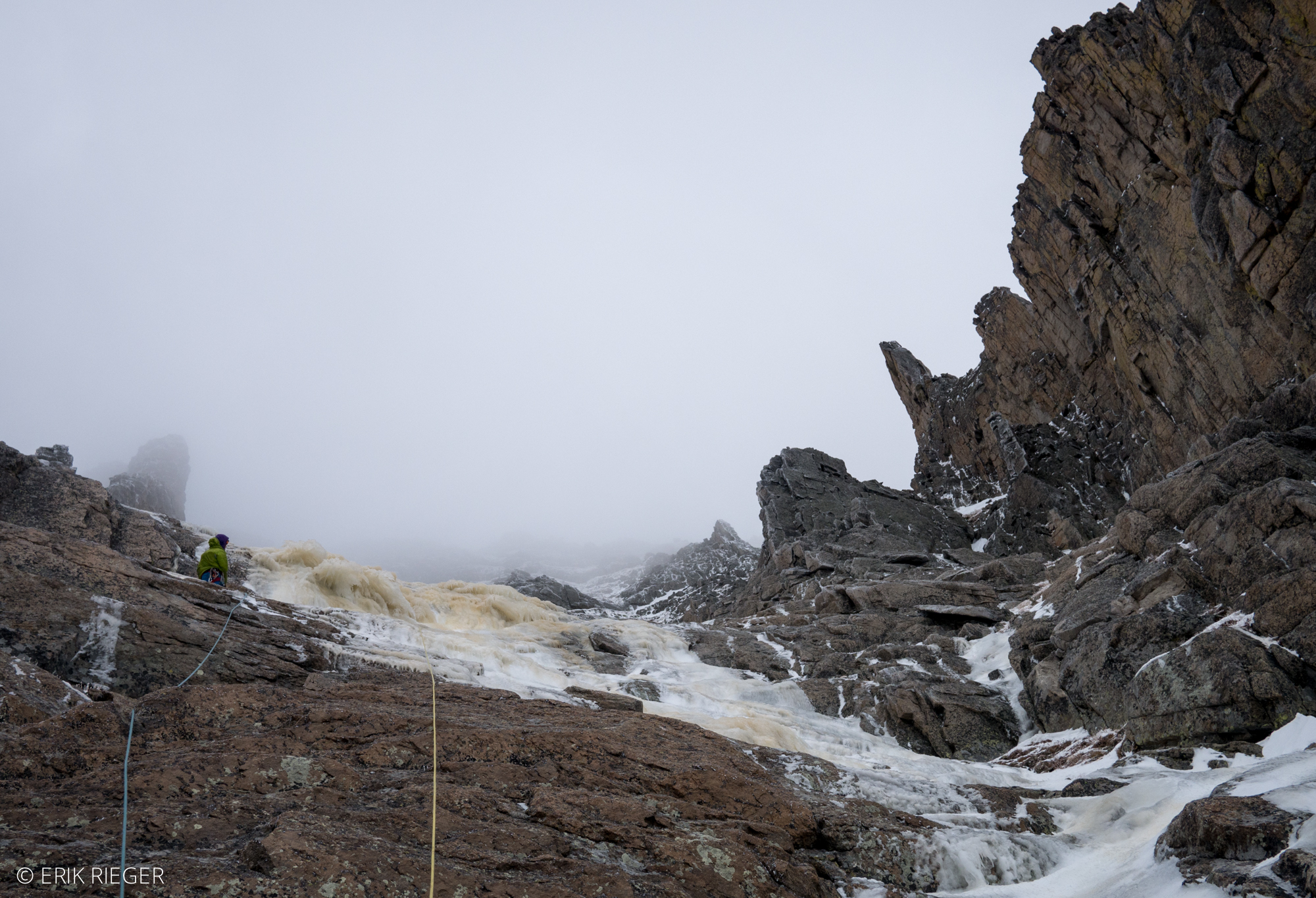 Climbing moderate and thick ice above the steep smear.