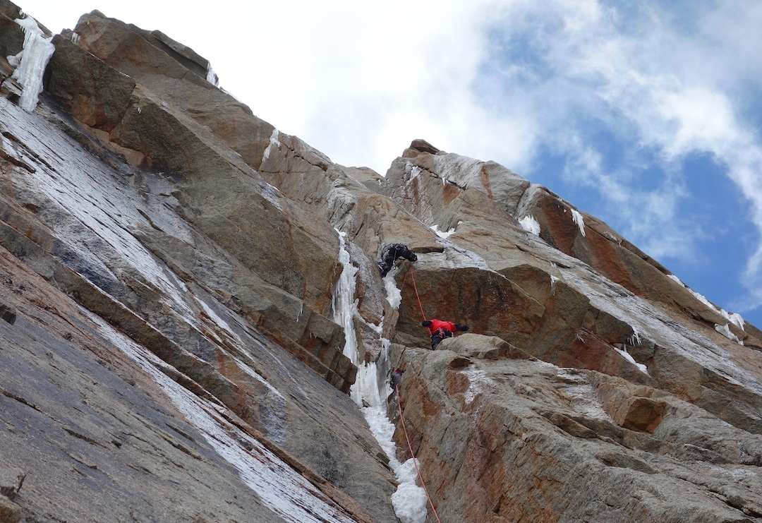 Sergey Nilov, belayed by Dmitry Golovchenko, works through steep ground between camps 3 and 4.