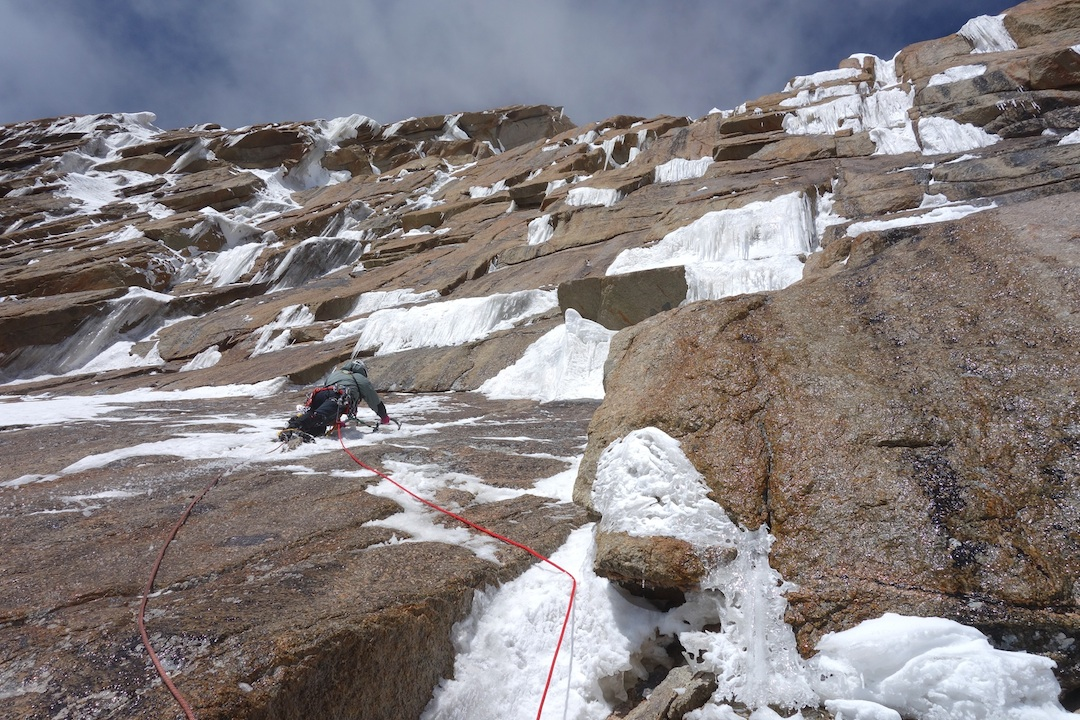 Sergey Nilov tackles thin mixed climbing on the first pitch above Camp 4.