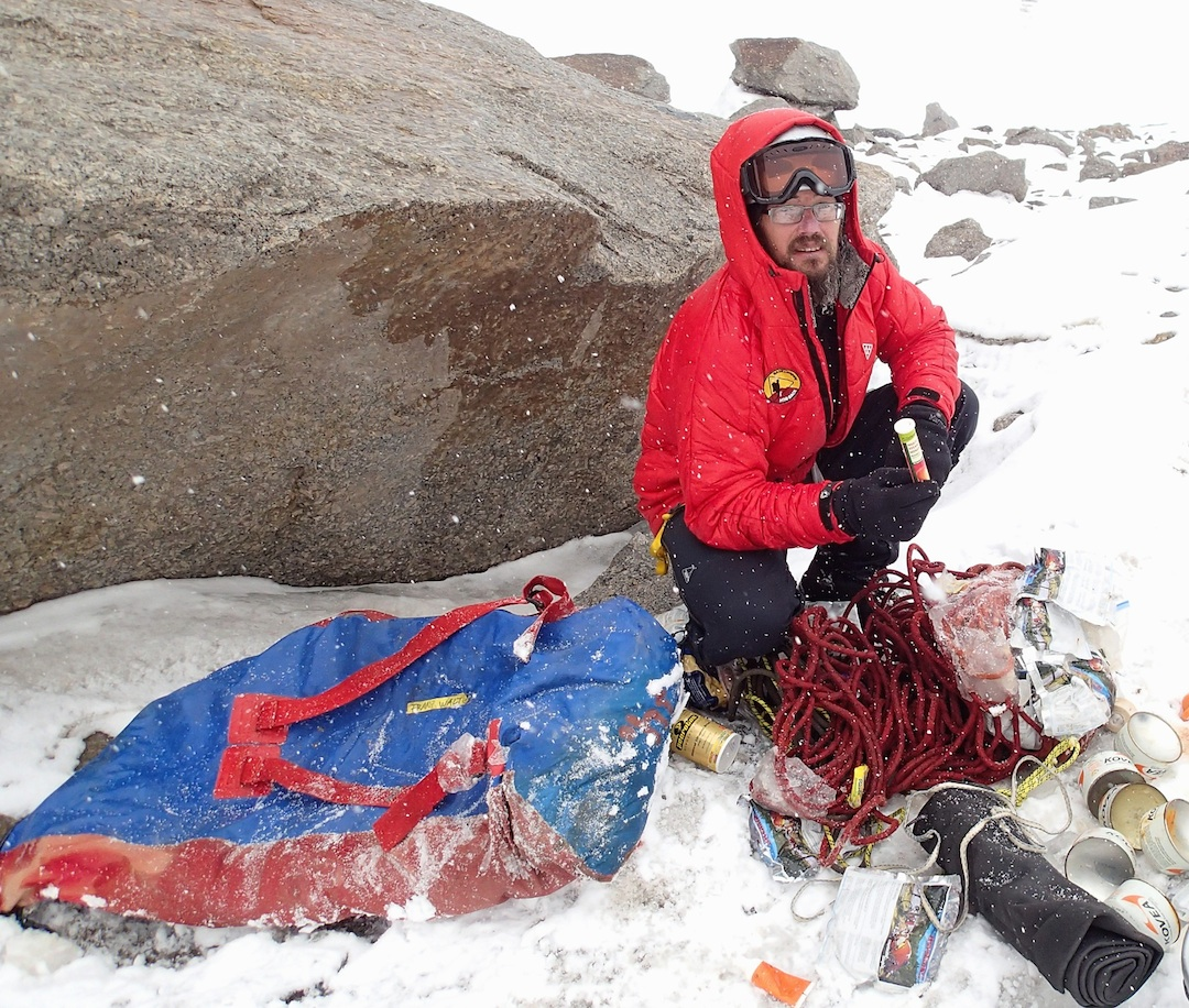 Sergey Nilov unpacks an abandoned German bag of gear, food, and, most usefully, ropes.