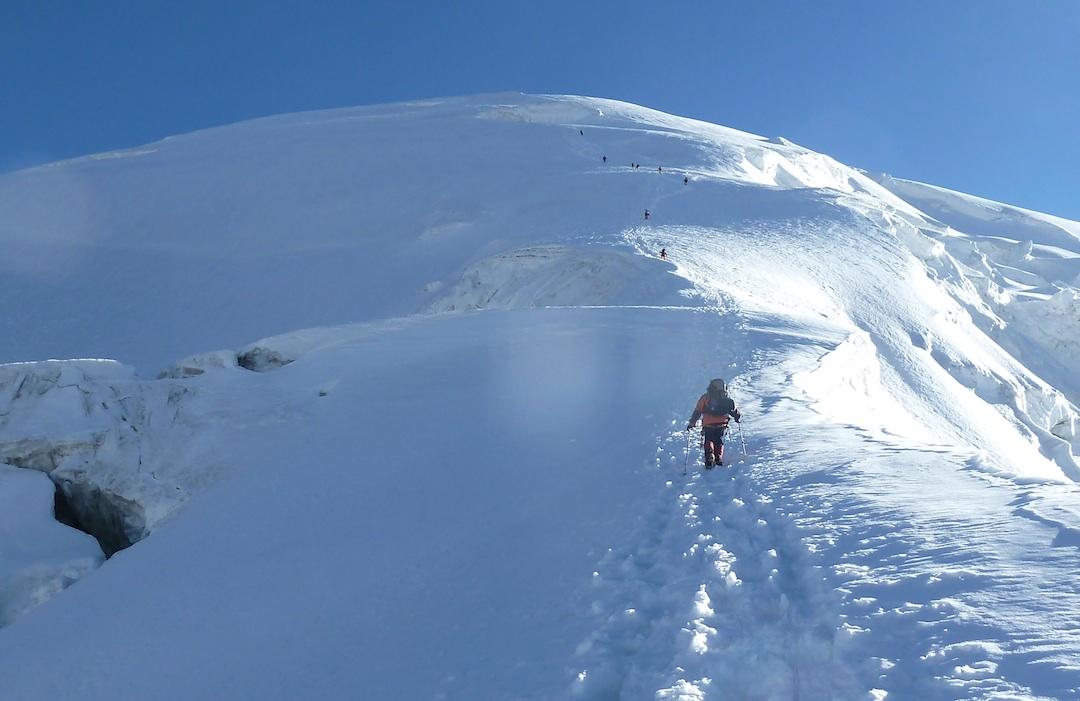 The party moves individually up the slopes of Kokodak Dome.