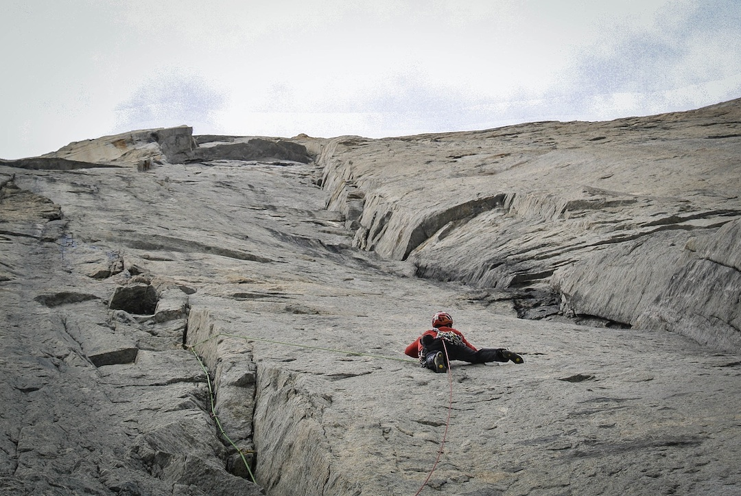 Matteo Della Bordella negotiates tricky face climbing between two crack systems on the Great Shark Hunt.